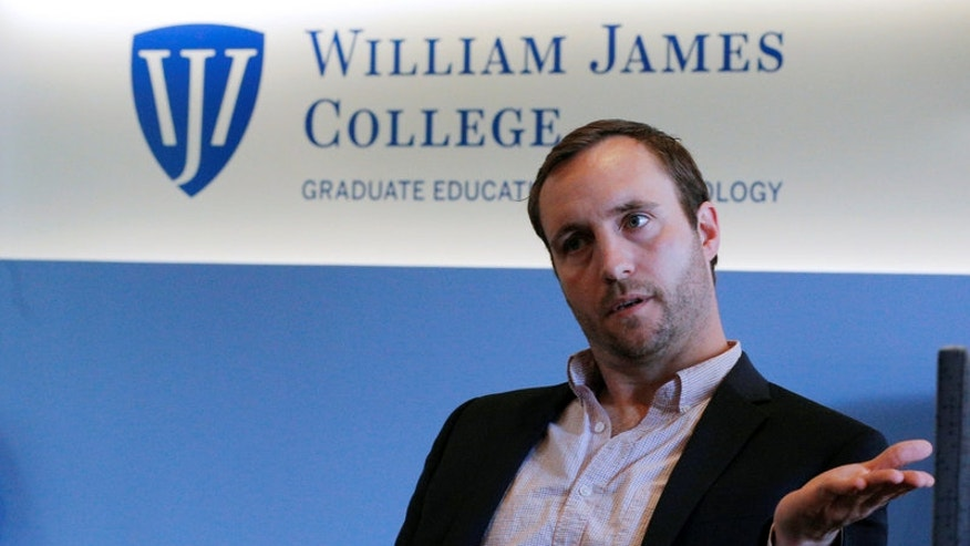 Travis Bickford speaks to Reuters at William James College of Psychology in Newton