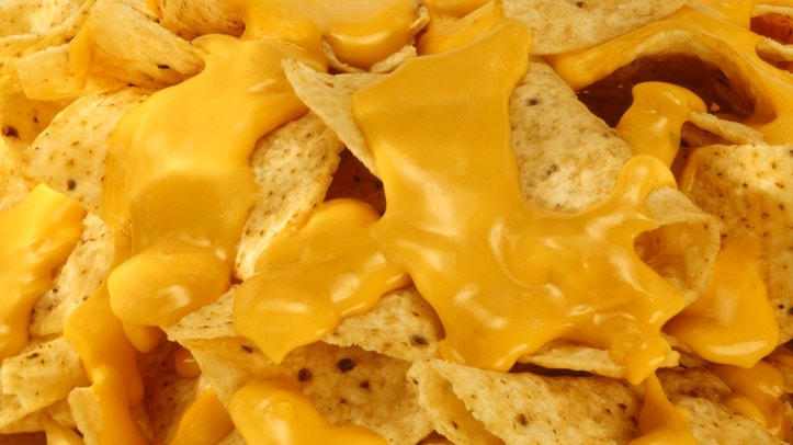 Restaurant style nachos and melted cheese.
