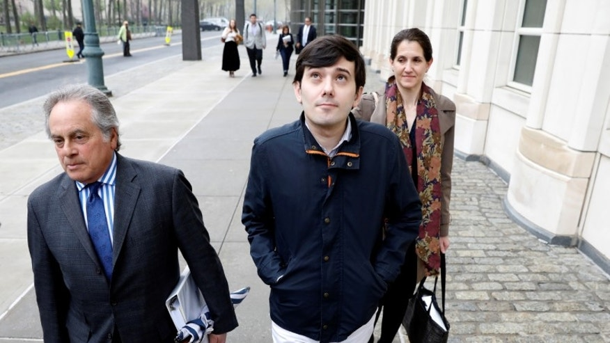 Martin Shkreli, former chief executive officer of Turing Pharmaceuticals and KaloBios Pharmaceuticals Inc, departs with his attorney Brafman after a hearing at U.S. Federal Court in Brooklyn, New York