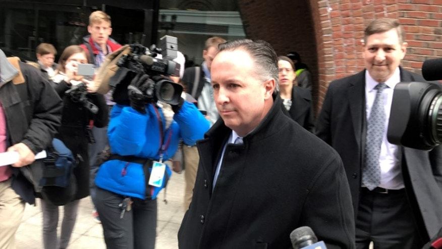 Barry Cadden exits the federal courthouse in Boston.
