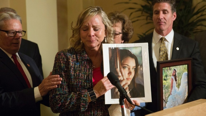 FILE - In this Sept. 11, 2015 file photo, Debbie Ziegler, mother of Brittany Maynard, speaks to the media after the passage of legislation, which would allow terminally ill patients to legally end their lives, at the state Capitol, in Sacramento, Calif. California health officials reported Tuesday, June 27, 2017, that 111 terminally ill people took drugs to end their lives in the first six months after a 2016 law made the option legal in the nation's most populous state. (AP Photo/Carl Costas)