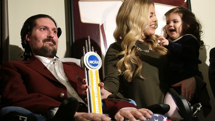 Dec. 13, 2016: In this file photo, former Boston College baseball captain Pete Frates, left, appears with his wife, Julie, center, and two-year-old daughter Lucy, right.