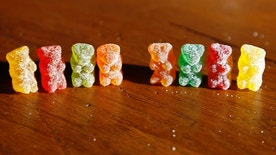 Marijuana-infused sour gummy bear candies (L) are shown next to regular ones at right in a photo illustration in Golden, Colorado October 17, 2014. As children around the country prepare their costumes in anticipation of Halloween goodies on Oct. 31, police in Colorado are warning parents that some treats may not be all they seem. Since Colorado and Washington this year became the first U.S. states to allow recreational sales of pot to adults, much of the public debate has focused on marijuana-infused products such as chocolates, cookies and candies, given their potential to attract children or be eaten accidentally. REUTERS/Rick Wilking (UNITED STATES - Tags: SOCIETY FOOD DRUGS HEALTH) - RTR4AL9G