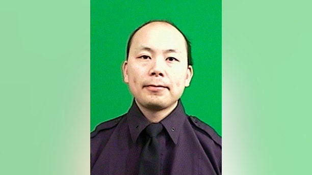 New York Police Officer Wenjian Liu, 32, is seen in an undated picture provided by the New York Police Department December 20, 2014. A gunman ambushed and fatally shot two New York City police officers on Saturday and then killed himself, police said, and a social media post indicated it may have been in revenge for the police chokehold death of an unarmed black man. Bratton identified the slain officers as Rafael Ramos, 40, and Wenjian Liu, 32. Liu had been married for two months.   REUTERS/NYPD/Handout via Reuters (UNITED STATES - Tags: CRIME LAW POLITICS CIVIL UNREST HEADSHOT) ATTENTION EDITORS - THIS IMAGE WAS PROVIDED BY A THIRD PARTY. FOR EDITORIAL USE ONLY. NOT FOR SALE FOR MARKETING OR ADVERTISING CAMPAIGNS. THIS PICTURE IS DISTRIBUTED EXACTLY AS RECEIVED BY REUTERS, AS A SERVICE TO CLIENTS - RTR4ITC3