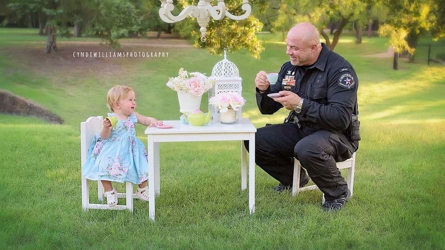 Evelyn Hall celebrated her first birthday with Deputy Constable Mark Diebold. (Cyndi Williams Photography)
