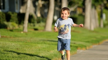 Four-year old Ely Bowman runs along the side walk as he plays in his neighborhood in Irvine, California