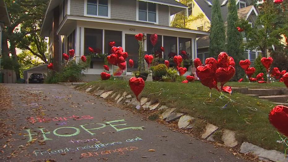 "Michele Slack planted set up a ""Hearts of Hope"" garden at one of the houses along her route."