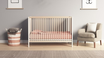 Rendering of a Modern nursery room with salmon red and grey accents