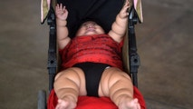 Ten-month-old baby Luis Gonzales is pictured in his stroller at a bus station in Colima city, Mexico on November 9, 2017.