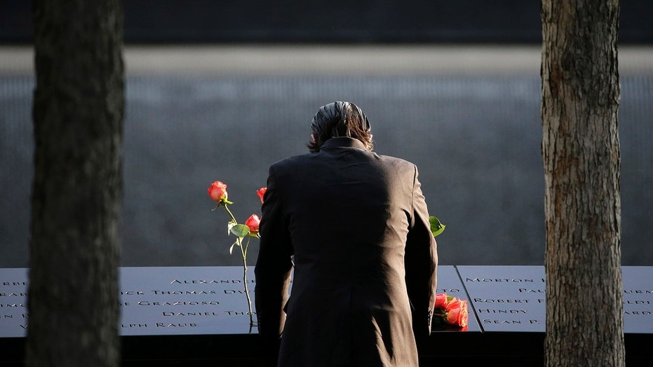 Sept. 11, 2017: A man stands at the edge of a waterfall pool at ground zero during a ceremony on the 16th anniversary of the 9/11 attacks in New York.