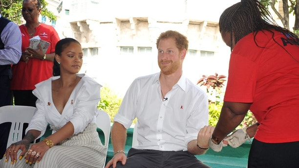 Britain's Prince Harry takes an HIV test alongside singer Rihanna to highlight World AIDS Day in Bridgetown, Barbados December 1, 2016.  REUTERS/Antonio Miller/Barbados Government Information Service (BGIS)/POOL - TM3ECC116HE01
