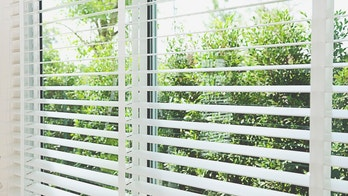 close up of home venetian blind at window