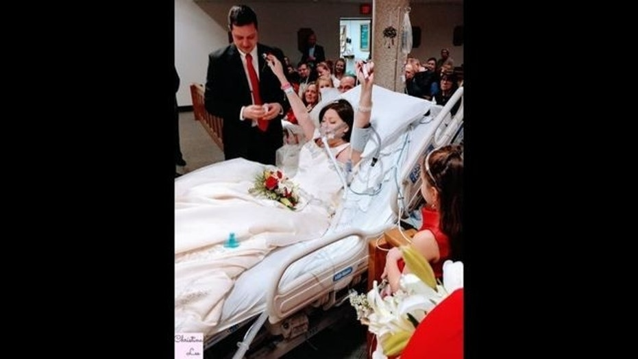 Heather Mosher was dressed in her wedding gown and lying in bed wearing an oxygen mask as she said 'I do.'