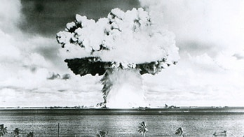 This U.S. Navy handout image shows Baker, the second of the two atomic bomb tests, in which a 63-kiloton warhead was exploded 90 feet under water as part of Operation Crossroads, conducted at Bikini Atoll in July 1946 to measure nuclear weapon effects on warships. The United States said on April 25, 2014, it was examining lawsuits filed by the Marshall Islands against it and eight other nuclear-armed countries that accuse them of failing in their obligation to negotiate nuclear disarmament.  REUTERS/U.S. Navy/Handout via Reuters (MARSHALL ISLANDS - Tags: POLITICS MILITARY CONFLICT) ATTENTION EDITORS - FOR EDITORIAL USE ONLY. NOT FOR SALE FOR MARKETING OR ADVERTISING CAMPAIGNS. THIS PICTURE WAS PROVIDED BY A THIRD PARTY. REUTERS IS UNABLE TO INDEPENDENTLY VERIFY THE AUTHENTICITY, CONTENT, LOCATION OR DATE OF THIS IMAGE. THIS PICTURE IS DISTRIBUTED EXACTLY AS RECEIVED BY REUTERS, AS A SERVICE TO CLIENTS - GM1EA4Q0L6601
