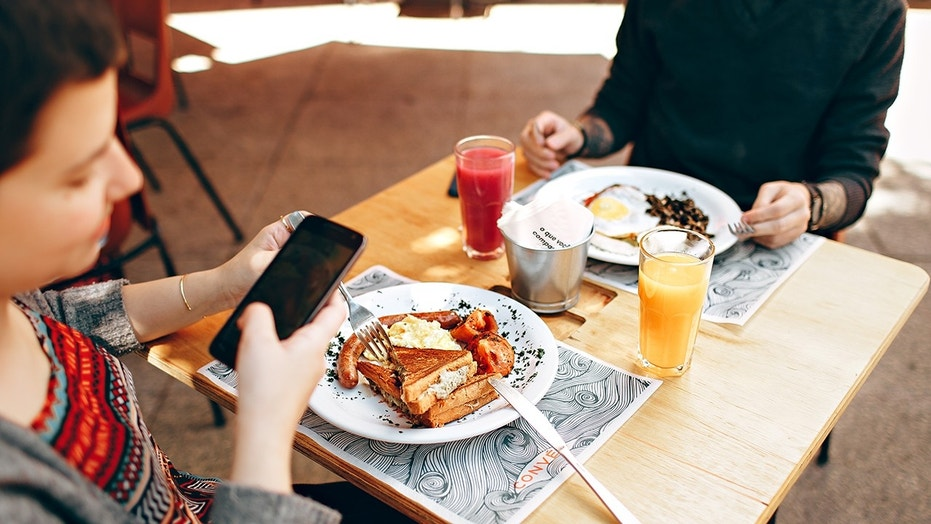 A study commissioned by Nutrisystem found Americans are easily distracted during mealtime by their cellphones.