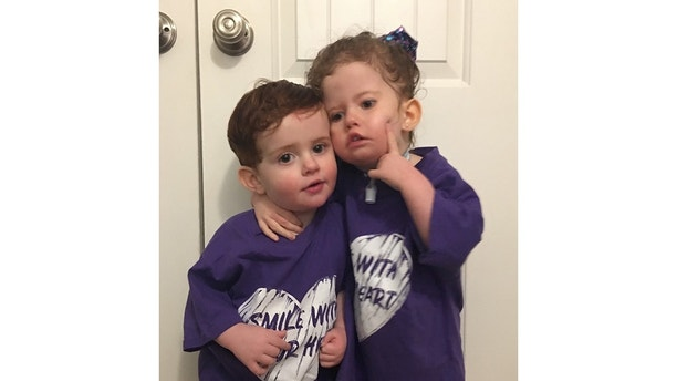 "Addison Garvey, 3, with her brother Jackson, 19 months.  See SWNS story NYSMILE; A mum and dad who have never seen their daughter smile due to a rare syndrome said a surgery to help her express herself for the first time would change their lives. Addison Garvey, three, was diagnosed with Moebius syndrome soon after she was born in December 2014 – a rare neurological condition that affects the muscles which control facial expression and eye movement. The rare syndrome, which affects one in ten million children, also means that Addison lives every night connected to a ventilator and a feeding tube as she has difficulty swallowing and breathing on her own. Addison's parents Jennifer Garvey, 29 and James Garvey, 36, said it has been very painful to have never seen their ""happy girl"" smile, but said a procedure called facial reanimation could help Addison express herself for the first time."