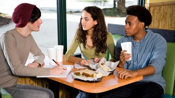 teens at diner istock