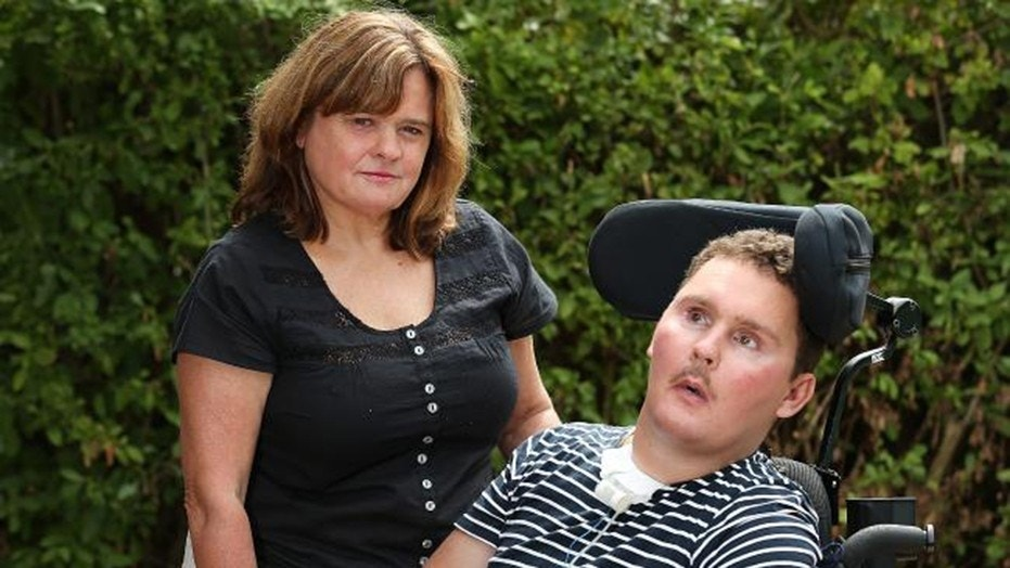 Sam Ballard (right) now needs 24/7 care from his mother Katie (left) and family after swallowing a garden slug as a dare and developing eosinophilic meningoencephalitis. They are in debt after the Australian government slashed funding. (News Corp Australia)