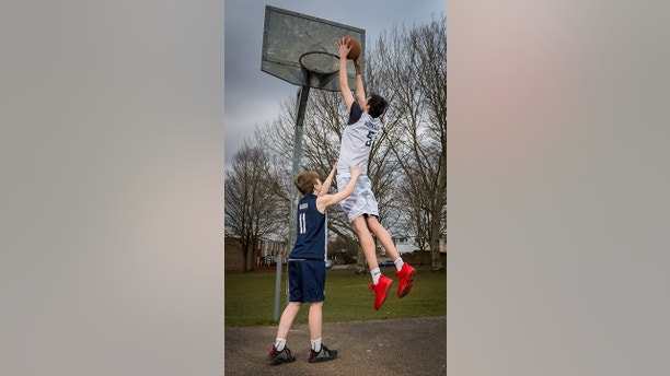 Seven foot tall Brandon Marshall age 16 with his friend and Under 16 County Upper Wolves team mate  14 year old Freddie Barber. See Masons copy MNTALL: Britain's tallest teenager is a real star in the making as he jets off overseas for his first professional basketball match.The 16-year-old real life BFG has started his training last week for the Wales National Basketball team ready for his first big match in Lithuania. Schoolboy Brandon Marshall is reaching a gigantic 7ft 3inchs with doctors saying there is still room for growth.