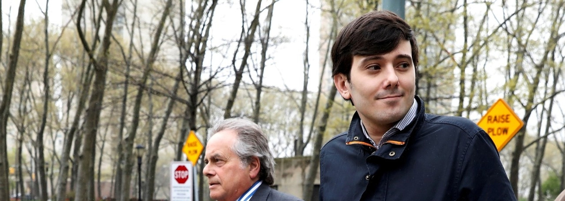 Martin Shkreli, former chief executive officer of Turing Pharmaceuticals and KaloBios Pharmaceuticals Inc, departs with his attorney Benjamin Brafman (L) after a hearing at U.S. Federal Court in Brooklyn, New York, U.S., April 26, 2017. REUTERS/Brendan McDermid - RC1E18CC3640