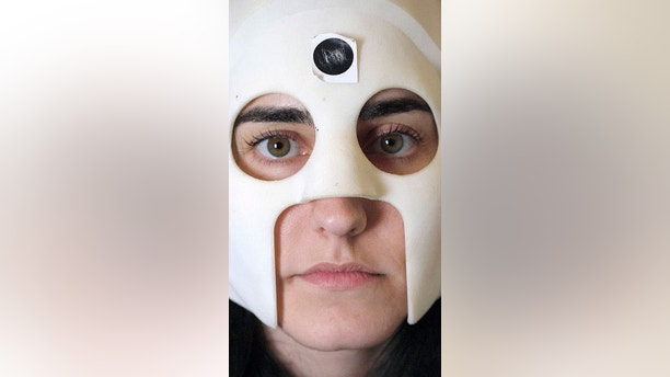 A woman is seen wearing a lightweight and highly sensitive brain imaging device in this undated handout photograph supplied by Wellcome and released in London, Britain March 22, 2018.  Wellcome/Handout via REUTERS  ATTENTION EDITORS - THIS IMAGE HAS BEEN SUPPLIED BY A THIRD PARTY. NO RESALES. NO ARCHIVES. - RC18863BA430