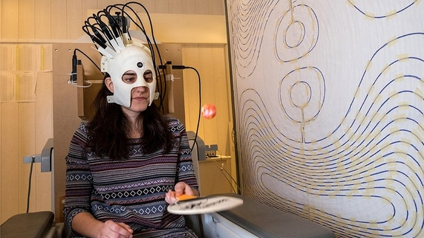 A woman is seen wearing a lightweight and highly sensitive brain imaging device in this undated handout photograph supplied by Wellcome and released in London, Britain March 22, 2018.  Wellcome/Handout via REUTERS  ATTENTION EDITORS - THIS IMAGE HAS BEEN SUPPLIED BY A THIRD PARTY. NO RESALES. NO ARCHIVES. - RC18B5D42180