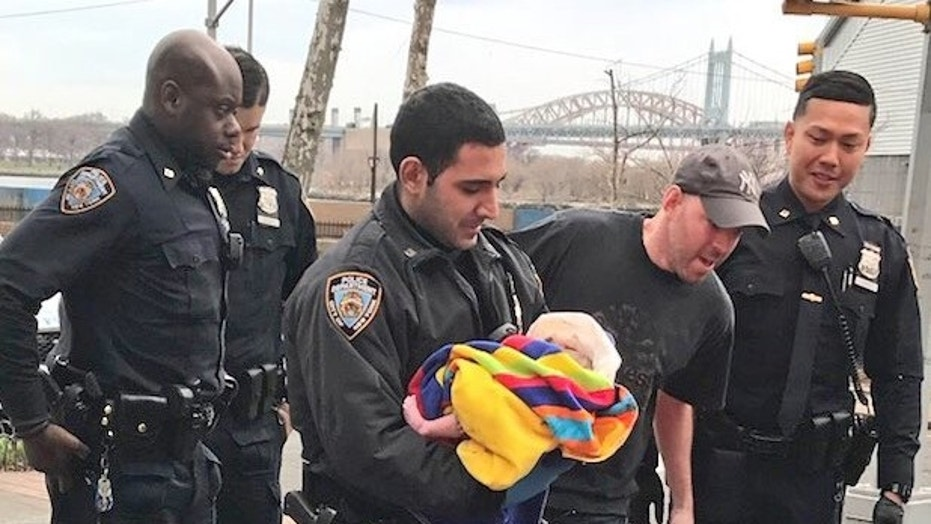 NYPD cops on Easter Sunday helped deliver a baby on the city's Upper East Side in the front seat of a car.