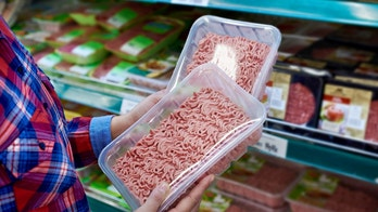 Buyer chooses minced meat in a store
