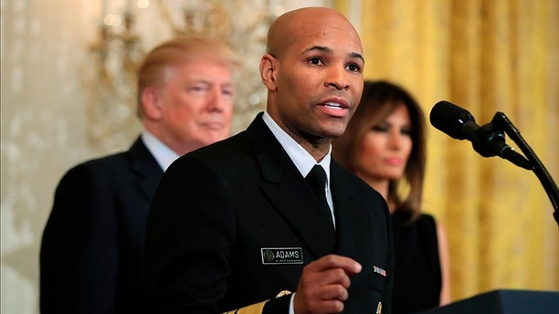 FILE - In this Feb. 13, 2018, file photo, Surgeon General Jerome Adams speaks during a National African American History Month reception hosted by President Donald Trump and first lady Melania Trump in the East Room of the White House in Washington. The nation's chief doctor wants more Americans to start carrying the overdose antidote naloxone in an effort to combat the nation's opioid crisis. U.S. Surgeon General Dr. Adams is expected to speak about the public health advisory Thursday, April 5, at the National Rx Drug Abuse & Heroin Summit in Atlanta. (AP Photo/Manuel Balce Ceneta, File)