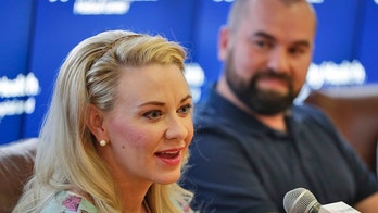 Jamie Scott speaks accompanied by her husband, Skyler, during a news conference at St. Joseph's Hospital and Medical Center in Phoenix on Friday, April 6, 2018. Jamie gave birth to quintuplets on March 21, 2018. The three girls and two boys, weighing less than 3 pounds each, will be able to leave the hospital in May according to the hospital. (AP Photo/Matt York)