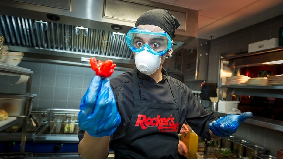 """Chef Rodrigo Recio with a """"Carolina Reaper"""" chili after an unidentified man in New York was left with thunderclap headaches from eating the famous pepper."""