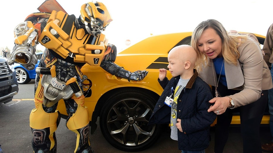 'Bumblebee' greets Hudson at his surprise party.