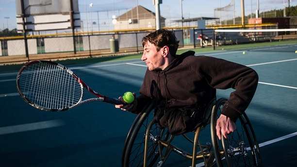 *** EXCLUSIVE - VIDEO AVAILABLE ***  MONTGOMERY, AL - JANUARY 17: Rowdy Burton, 30, who has just half a body, gets ready to rally with his friend during a game of tennis on January 17, 2018 in Montgomery, Alabama.  DESPITE living with just half a body – inspirational Rowdy Burton is determined to not let his condition define him. 30-year-old, Rowdy, was born with a rare lower spinal disorder called Sacral Agenesis. Affecting only one in 25,000 births, the condition resulted in Rowdy having both of his legs amputated when he was just three years old – with doctors using pins to stop his bones growing any further. Rowdy, who resides in Alabama, USA, was left to live his life with two stumps positioned directly beneath his waist and now that he is older, he prefers to use his hands and elbows to get around rather than a wheelchair. After all the hardship Rowdy has faced over the years, he is still determined to live his life to the full – playing tennis with his friends and riding his skateboard.   PHOTOGRAPH BY Bob Miller / Barcroft Images