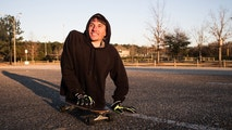 *** EXCLUSIVE - VIDEO AVAILABLE ***MONTGOMERY, AL - JANUARY 17: Rowdy Burton, 30, who has just half a body - rides on his skateboard and looks to the distance on January 17, 2018 in Montgomery, Alabama.DESPITE living with just half a body – inspirational Rowdy Burton is determined to not let his condition define him. 30-year-old, Rowdy, was born with a rare lower spinal disorder called Sacral Agenesis. Affecting only one in 25,000 births, the condition resulted in Rowdy having both of his legs amputated when he was just three years old – with doctors using pins to stop his bones growing any further. Rowdy, who resides in Alabama, USA, was left to live his life with two stumps positioned directly beneath his waist and now that he is older, he prefers to use his hands and elbows to get around rather than a wheelchair. After all the hardship Rowdy has faced over the years, he is still determined to live his life to the full – playing tennis with his friends and riding his skateboard. PHOTOGRAPH BY Bob Miller / Barcroft Images