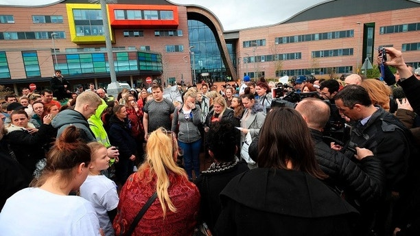 "Protesters gather outside Alder Hey Children's Hospital in Liverpool, England, Monday April 23, 2018  after the European Court of Human Rights rejected an appeal against the decision to end life-support for Alfie Evans, a terminally-ill toddler. Alfie is in a ""semi-vegetative state"" as the result of a degenerative neurological condition that doctors have been unable to definitively identify. (Peter Byrne/PA via AP)"