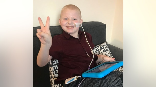 """Jay Crouch, 7, post operation, has been given 5 new organs after undergoing a multi-transplant operation at Birmingham Children's Hospital. See NTI story NTIORGAN; A seven-year-old boy dubbed a """"superhuman"""" is one of the youngest patients in Britain to undergo a multi-transplant operation to successfully replace FIVE organs. Brave Jay Crouch received two new kidneys, a liver, a small intestine and pancreas from a single donor. When he was just six weeks old his small intestine became twisted which caused extensive damage to his major organs. During his life, Jay was diagnosed with anaemia, having small bowel syndrome and chronic renal failure. As a result of his health problems, Jay was fed using a tube, but was able to taste and swallow food for the first time following the multiple organ transplant."""