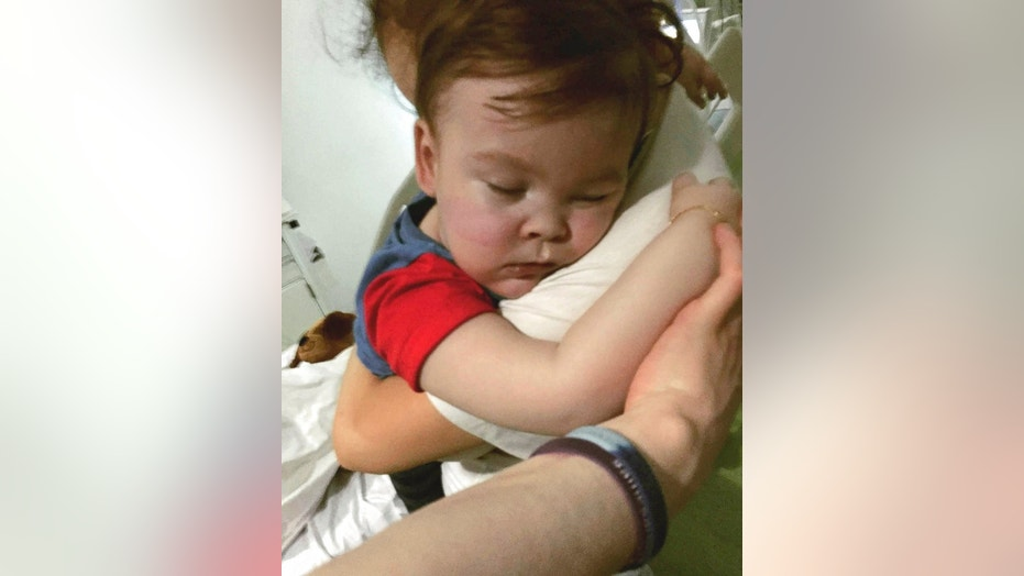 Brain-damaged toddler Alfie Evans, has died, his parents announced early Saturday. Alfie is seen in the arms of his mother, Kate James at Alder Hey Hospital, Liverpool, England, April 23, 2018.