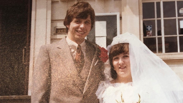 Collect photo of Danny Hunt on his wedding day to wife Mandy. See National News story NNCANCER; Eye cancer misdiagnosed as migraine ate a giant hole in a father-of-four's face. Doctors told Danny Hunt, 58, he was suffering from migraines before it was discovered he had a severe form of cancer in his eye. Mr Hunt's right eye was removed along with bone in his nose and jaw.  Now doctors have created a special 'flap' using skin from his back and an artery in his leg to cover the horrific hole in his face caused by the cancer.