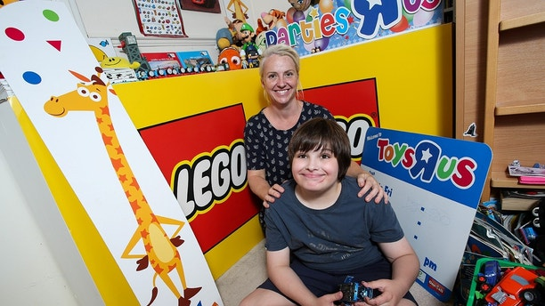 Blue Martin, 11, who has autism, with his mum Becky and the signs he received from Toys R Us in Gloucester after it closed. Blue's mum Becky tweeted the store asking if Blue could have one of their signs as he loves the shop and was devastated when it closed. Cheltenham, Gloucestershire. An autistic 11-year-old who was left 'devastated' by the closure of his nearest Toys'r'Us store - was presented with a selection of gifts by the store on the day that it closed. Blue Martin has been frequenting the giant toystore since he was a tot, and his parents had to console him for weeks following the announcement of the store's closure. His mum Becky Martin, 43, says Blue's autism means he has 'very particular likes and obsessions'. She explained that the youngster, who also has unstable Type One diabetes, saves all the Toys'r'Us adverts and even watches the older ones on YouTube. And when Becky, an autism awareness campaigner, tweeted the store to ask if Blue could have something to remember them by, the store's providers went out of their way to help.