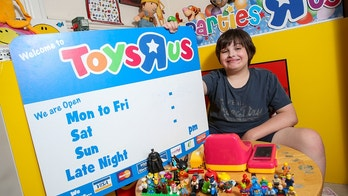 Blue Martin, 11, who has autism, with the signs he received from Toys R Us in Gloucester after it closed. Blue's mum Becky tweeted the store asking if Blue could have one of their signs as he loves the shop and was devastated when it closed. Cheltenham, Gloucestershire. An autistic 11-year-old who was left 'devastated' by the closure of his nearest Toys'r'Us store - was presented with a selection of gifts by the store on the day that it closed. Blue Martin has been frequenting the giant toystore since he was a tot, and his parents had to console him for weeks following the announcement of the store's closure. His mum Becky Martin, 43, says Blue's autism means he has 'very particular likes and obsessions'. She explained that the youngster, who also has unstable Type One diabetes, saves all the Toys'r'Us adverts and even watches the older ones on YouTube. And when Becky, an autism awareness campaigner, tweeted the store to ask if Blue could have something to remember them by, the store's providers went out of their way to help.