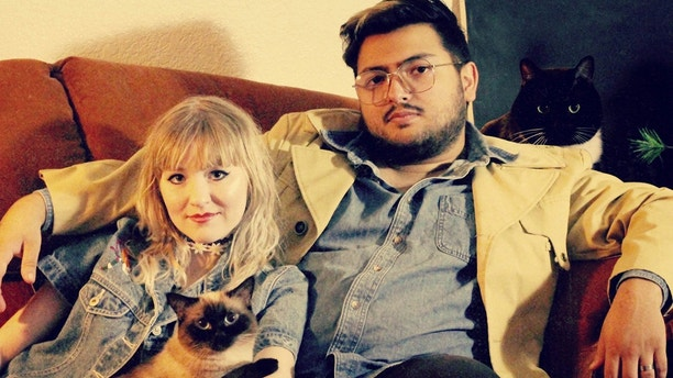 """Violet Gomez and husband Erik with their cats Sushi and Taki. See SWNS story NYLUNGS A young cystic fibrosis sufferer took her first steps days after receiving a life-saving double lung transplant. Violet Gomez, 25, said she feels """"free"""" following the surgery, which means she can breathe deeply for the first time in her life. The young woman previously relied on oxygen 24/7 after a build of mucus in her organs reduced her lung capacity to 20 per cent. While her friends graduated college and enjoyed life, Violet was so unwell she was unable to walk the length of her apartment without taking a break. Earlier this year, a series of infections left Violet virtually hospital-bound and hooked up to an oxygen tank to help her breathe. She was added to the transplant list in April and expected to be waiting three to six months for a new pair of lungs, in line with average US wait times. But just six days later she received the all-important call and was rushed to hospital where she underwent the critical surgery in the early hours of April 12. Footage filmed at Stanford Medical Center in Palo Alto, California, shows Violet taking her first steps fueled by healthy lungs full of oxygen, just two days after the op. The aspiring fashion designer, who was unable to work before the transplant but now plans to go to school, said: """"It is freeing. I feel free."""