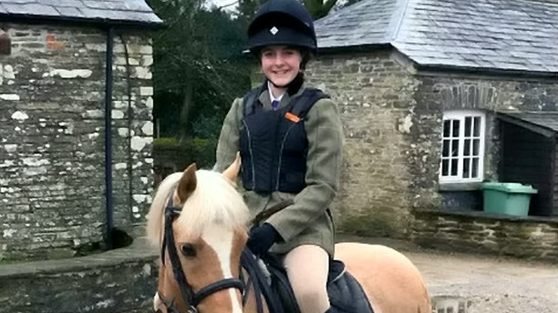 Georgia Hull, 14 and her beloved pony. See SWNS story SWHORSE; Shocking injury pictures show a 14-year-old girl in hospital after she lost five teeth when a horse kicked her in the face. A brave teenager from Wadebridge is riding her pony again just days after a horse kicked her in the face, causing her to lose five teeth and unable to eat solids. Georgia Hull, 14, was out trail hunting with friends and family when a horse in front of her kicked out just over two weeks ago on private land near the town. Horrified mother Julie was just ahead of Georgia on her own horse when she heard the screams coming from behind. Georgia was knocked unconscious and had to spit her teeth out, while her swollen mouth left her unable to breathe. She also sustained multiple facial fractures, including severe damage to her jaw, and cuts to her face that have required stitches.