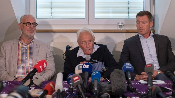Philip Nitschke, founder and director of the pro-euthanasia group Exit International, 104-year-old Australian scientist David Goodall and lawyer Moritz Gall, from left, attenda press conference a day before Goodall's assisted suicide in Basel, Switzerland, on Wednesday, May 9, 2018. (Georgios Kefalas/Keystone via AP)