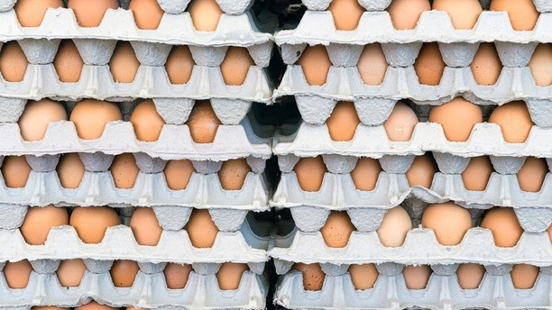 Brown eggs in boxes at farmer's market