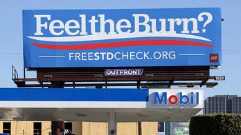 "FILE - This April 1, 2016 file photos shows a billboard above a gas station that reads ""Feel The Burn,"" a play on then-presidential candidate Bernie Sanders' campaign slogan, ""Feel The Bern."" It's actually promoting testing for sexually transmitted diseases. The number of cases of STDs - chlamydia, gonorrhea and syphilis - in California reached a record high in 2017,and officials are particularly concerned by a spike in stillbirths due to congenital syphilis, state health authorities said Monday, May 14, 2018. (AP Photo/Nick Ut, File)"