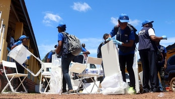World Health Organization workers prepare a centre for vaccination in the port city of Mbandaka
