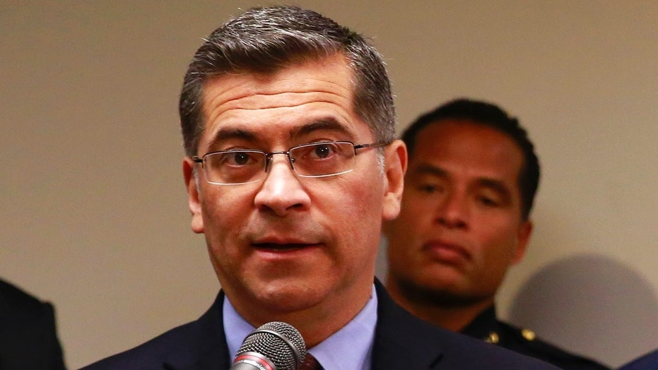 In this March 27, 2018 file photo, California Attorney General Xavier Becerra addresses reporters at a news conference in Sacramento. Becerra on Friday praised the reinstatement of California's right-to-die law.