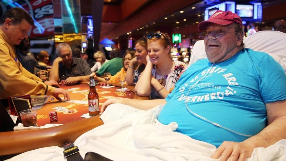 Mudry arrived at Bally's via ambulance on Tuesday, and had his bed placed next to a blackjack table where he enjoyed a Coors Light.