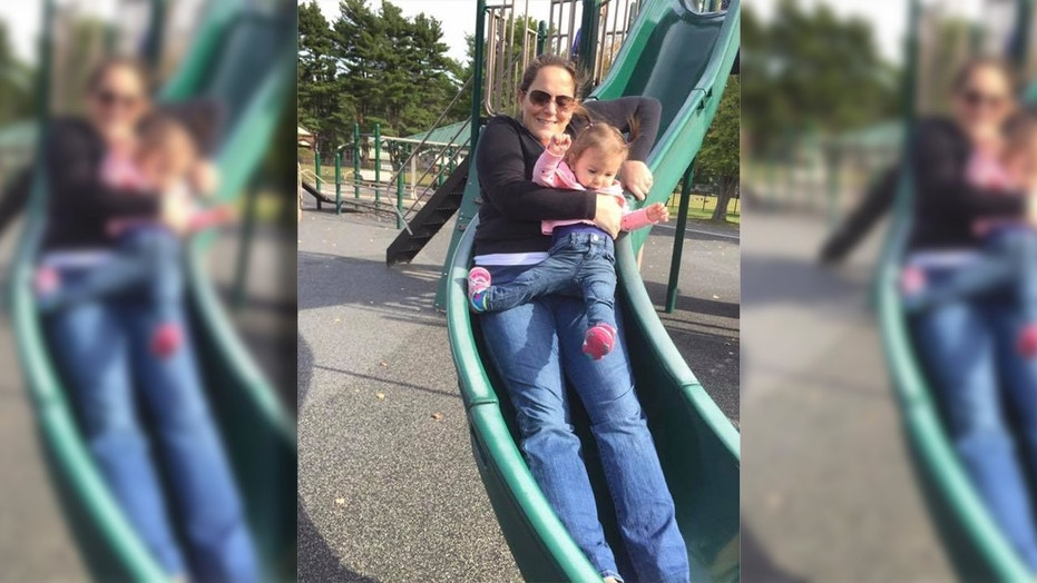 Heather Clare wants the photo to serve as a warning to other parents about the dangers of going down on a slide with your child.