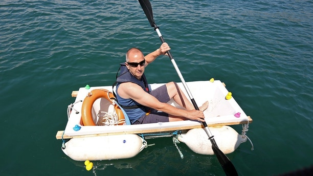 """PIC: MARK PASSMORE/APEX 14/07/2018Pictured: Plumber Iain Bevan, 51, rows across seas at Torbay inside a bath tub to raise money for charity.The plughole was tightly sealed for the voyage from Torquay to Paignton in Devon as Iain aimed to raise thousands of pounds for research into cancer which claimed his mother and father-in-law.""""I thought what's the most ridiculous thing a plumber can do to raise some money,"""" he said. """"So I came up with this.""""His wife Anita took a bit of convincing, he said.""""She told me I was mad. She punched me on the arm and told me not to be so ridiculous. """"Then I explained a bit more about it and she is right behind me now.""""Iain hopes to raise £10,000 for Cancer Research and Torbay Hospital.VIDEO AVAILABLE: https://youtu.be/iWrngPIdwwI£50 FEE FOR USE* Consent has been given for this photo *SEE STORY BY APEX NEWS - 01392 823144----------------------------------------------------APEX NEWS AND PICTURESNEWS DESK: 01392 823144PICTURE DESK: 01392 823145"""